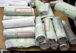 Ballots with the Ahmadinejad's name written in the same handwriting and using the same pen.